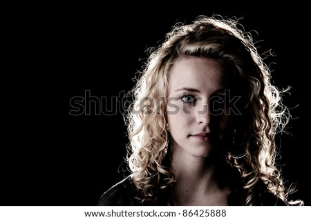 Portrait of a beautiful teenager girl with long curly hair