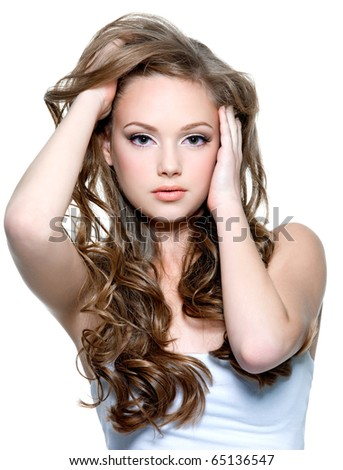 Portrait of a beautiful teenager girl with  long curly hairs - isolated on white