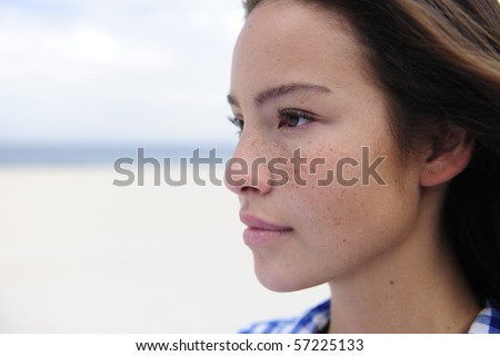 portrait of a beautiful woman at the sea with copy space