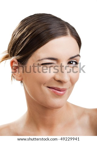 Portrait of a beautiful woman blinking eyes, isolated on white
