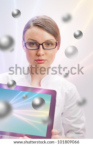 Portrait of a beautiful woman doctor with tablet pc