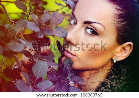 Portrait of a beautiful woman in autumn park.