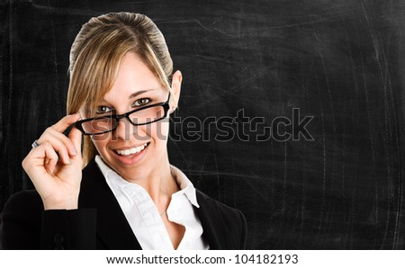 Portrait of a beautiful woman in front of a blackboard