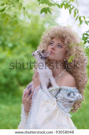 Portrait of a beautiful woman in medieval dress with cat