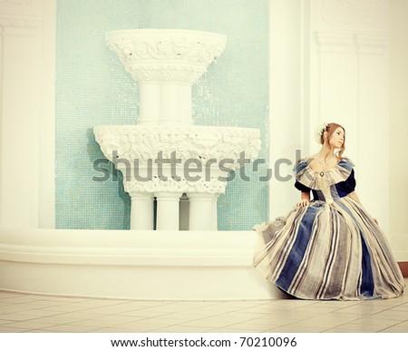 Portrait of a beautiful woman in medieval era dress.