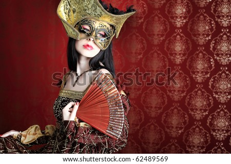 Portrait of a beautiful woman in medieval era dress. Shot in a studio. - stock photo