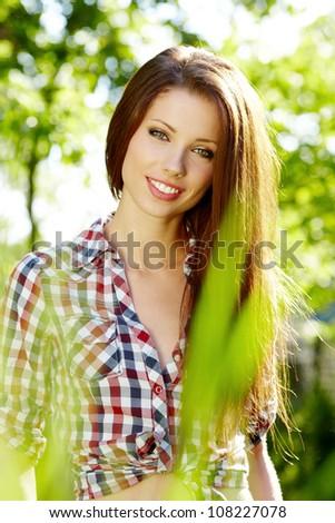 Portrait of a beautiful woman in the garden