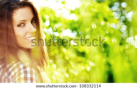 Portrait of a beautiful woman in the garden