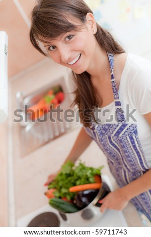 Portrait of a beautiful woman in the kitchen