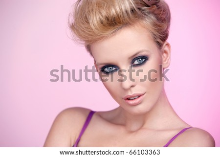 Portrait of a beautiful woman isolated on pink background