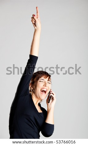 Portrait of a beautiful woman making a phone call and very happy with the good news