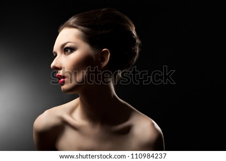 Portrait of a beautiful woman on a black background.