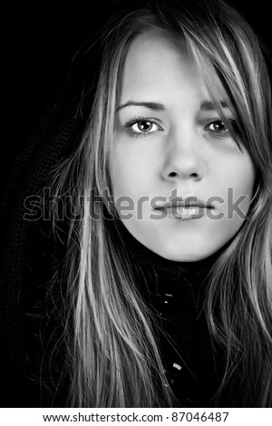 Portrait of a beautiful woman on a black background