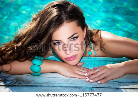 Portrait Of A Beautiful Woman Posing By The Pool, Summer Day, Outdoor