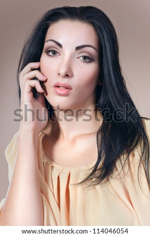 Portrait of a beautiful woman, she is speaking by telephone