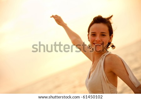 Portrait of a beautiful woman smiling at sunset outdoors #61450102