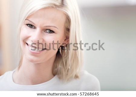 portrait of a beautiful woman smiling indoors #57268645