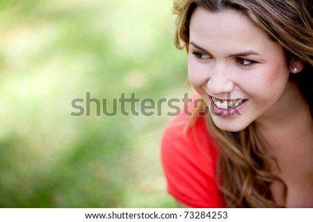 Portrait of a beautiful woman smiling outdoors