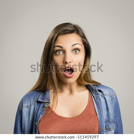 Portrait of a beautiful woman with a surprised face #511459297