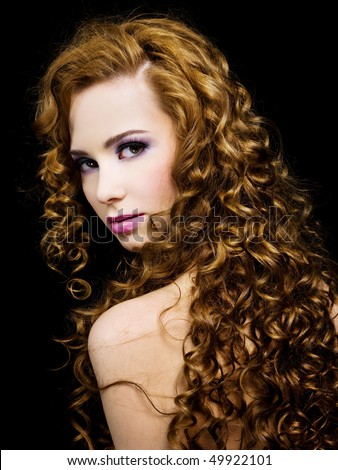 Portrait of a beautiful  woman with beauty  long ringlets hairs with fashion bright pink make-up of eyes and lip.