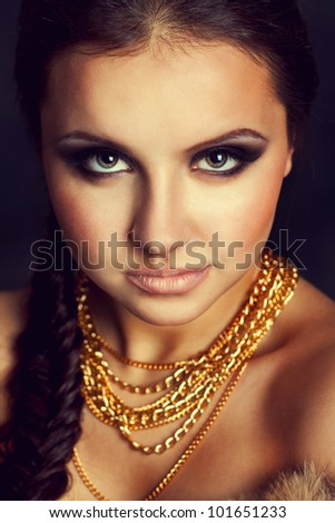 Portrait of a beautiful woman with golden chains