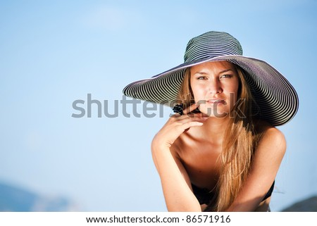 portrait of a beautiful woman with hat - stock photo