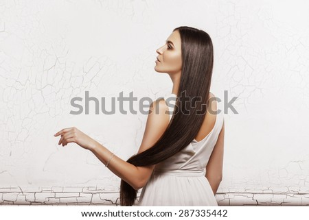 Portrait of a beautiful woman with long hair #287335442