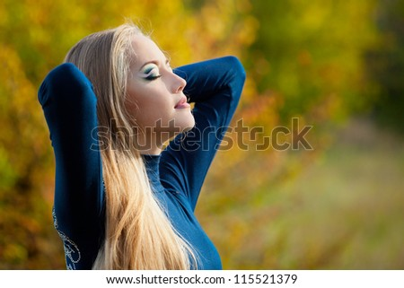 Portrait of a beautiful woman with long hair in the autumn day. Soft Focus