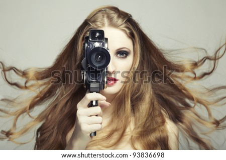 Portrait of a beautiful woman with the camera. Fashion photo
