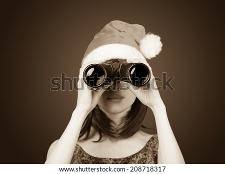 Portrait of a beautiful women with binocular. Photo in old sepia image style.