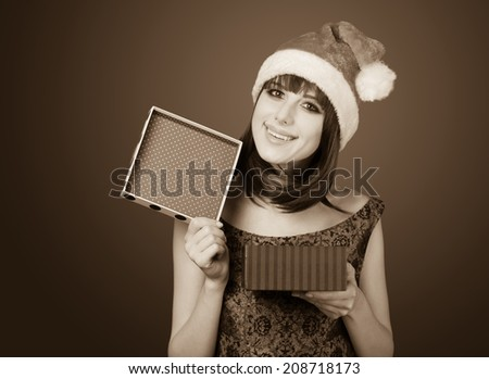 Portrait of a beautiful women with gift box. Photo in old sepia image style.