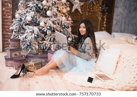 Portrait of a beautiful working girl on the eve of Christmas. winter holidays and people concept. Happy New Year to you!
