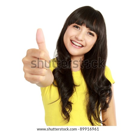 Portrait of a beautiful young asian woman showing thumbs up. Isolated on white background