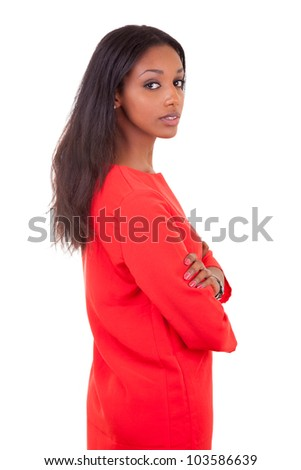 Portrait of a beautiful young black woman with folded arms isolated on white background