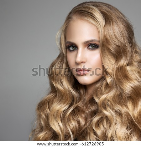 Portrait Of A Beautiful Young Blond Woman With Long Wavy Hair #612726905