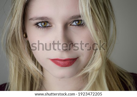Portrait of a beautiful young blonde woman with red lipstick and intense gaze  Stock photo ©