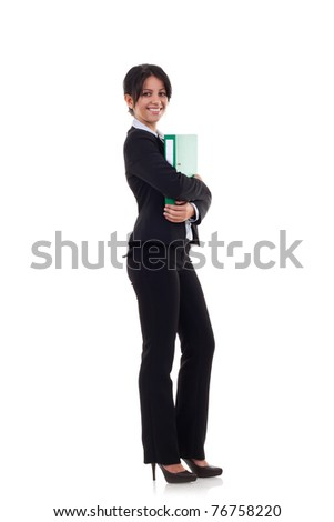 Portrait of a beautiful young business woman holding a folder, full length