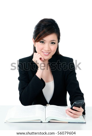 Portrait of a beautiful young businesswoman holding a mobile phone over white background.
