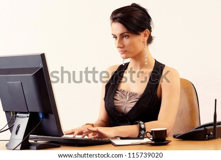 portrait of a beautiful young businesswoman on a beige background