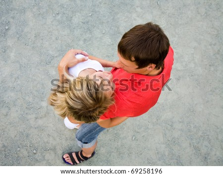 Portrait of a beautiful young couples are happily embracing at walk. Top view
