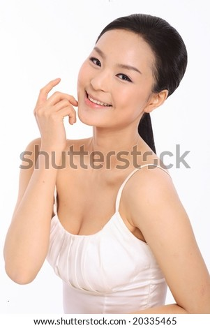 Portrait of a Beautiful Young Female - face with hand posing