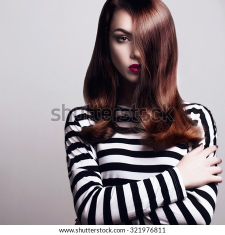 Portrait of a beautiful young girl with smooth hair
