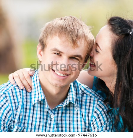 Portrait of a beautiful young happy smiling couple - green park outdoor