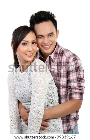 Portrait of a beautiful young happy smiling couple isolated on white background