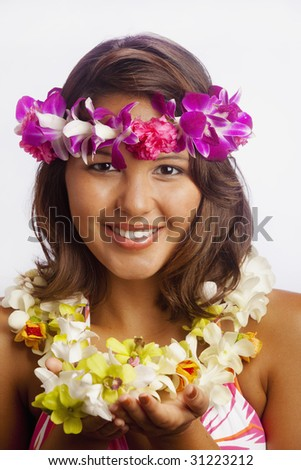 portrait of a beautiful young Hawaiian girl with flower lei smiling