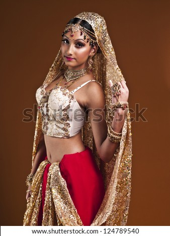 Portrait of a beautiful young Indian bride posing for the camera