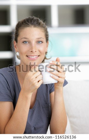 Portrait of a beautiful young lady with cup