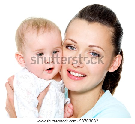 Portrait of a beautiful young mother with sweet newborn child
