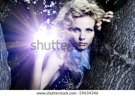 stock photo : Portrait of a beautiful young sexy woman on a tree