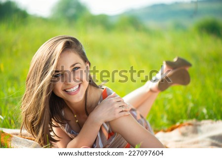 Portrait of a beautiful young smiling girl stock photo
